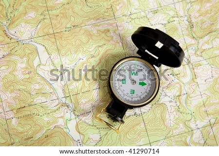 A compass on a topographical map