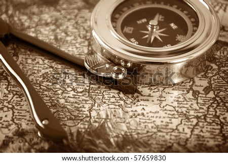 A compass on the old map