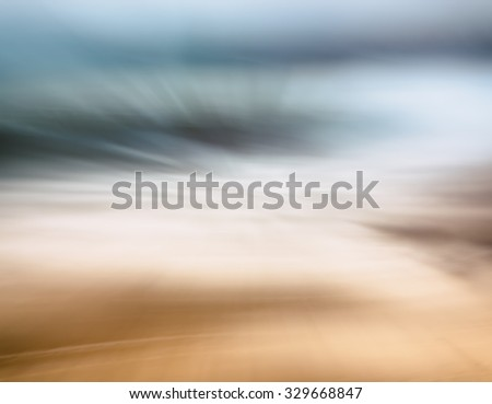 A complete abstraction of waves, sand, ocean and sky.  Image features a brown to blue color gradient.