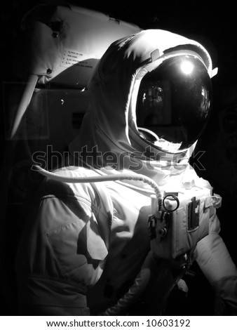 A complete astronaut setup under dramatic lighting.  Black and white. - stock photo