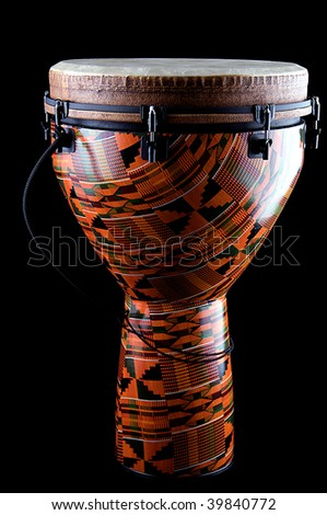 A complete orange African or Latin Djembe conga drum isolated on black background in the vertical format. - stock photo