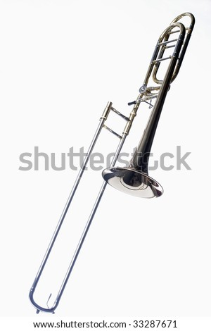 A complete slide trombone isolated against a white background in the vertical format. - stock photo