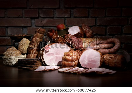 A composition of different sorts of sausages on dark background - stock photo