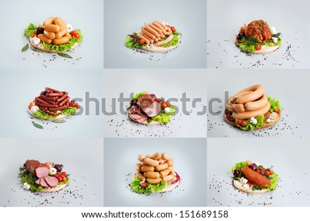 A composition of different sorts of sausages on the wood board with fresh vegetable - stock photo