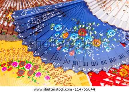 A composition of lots of spanish fans - stock photo