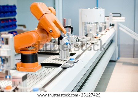 A computer controlled automated manufacturing process - stock photo
