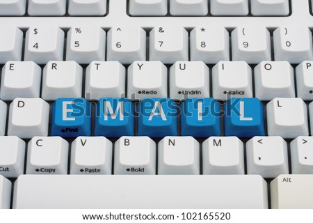 A computer keyboard with blue keys spelling email, Checking your email - stock photo
