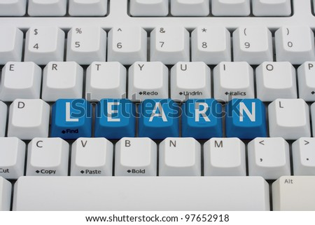 A computer keyboard with blue keys spelling learn, Learn online - stock photo