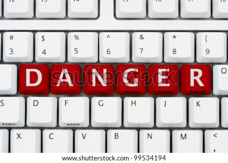 A computer keyboard with red keys spelling danger, Danger on the internet