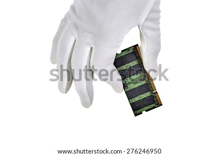 A computer memory chip hand held with hand in white glove and isolated on white - stock photo