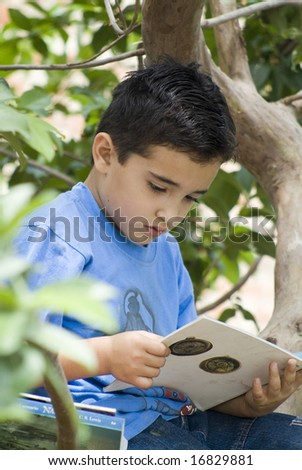 A concentrate boy reading