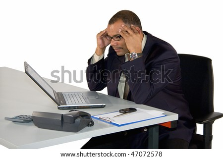 a concentrated working African-American mature businessman, isolated on white background - stock photo