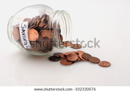 A concept image of jar with pennies to signify saving money or saving pennies