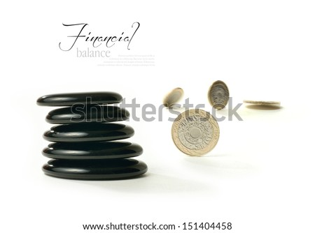 A concept image relating to financial matters. Spinning coins representing investments, pension or savings with Feng Shui black stones representing balance. White background with copy space. - stock photo