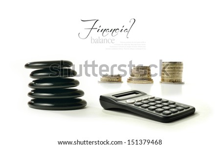 A concept image relating to financial matters. Stacked coins representing investments, pension or savings with Feng Shui black stones representing balance. Generic calculator.  Copy space. - stock photo