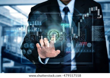 A concept of a businessman entering investment market in a touchscreen internet trading platform