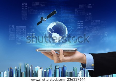 A concept of global internet connection on a smart phone with futuristic city background - stock photo