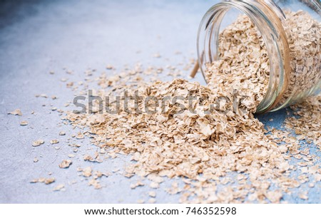 A concept of healthy breakfast with spilled oatmeal