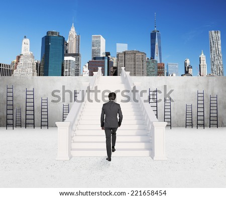 A concept of successful career. Businessman is climbing on the top of the rank. - stock photo