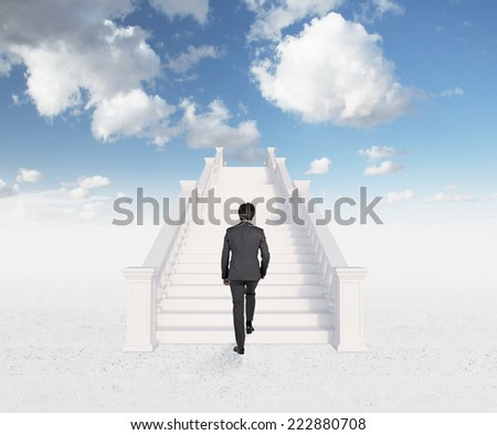 A concept of successful career. Businessman is climbing on the top of the world.  - stock photo
