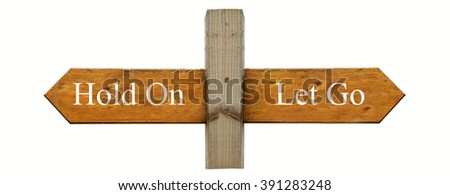 A concept sign indicating ;Let Go' to the right and 'Hold On' to the left - stock photo