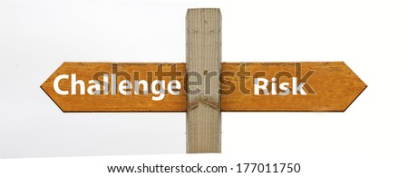 A concept signpost pointing to challenge or risk - stock photo