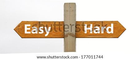 A concept signpost pointing to easy or hard - stock photo