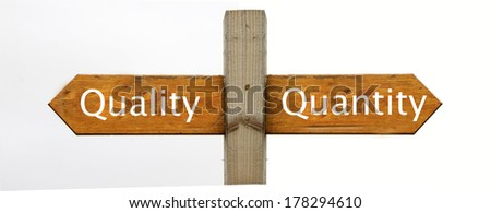 A concept signpost pointing to Quality or Quantity - stock photo