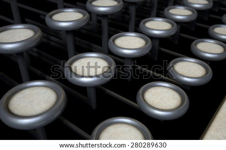A concept view of an extreme close up of blank unmarked keys of a vintage typewriter on a dark background