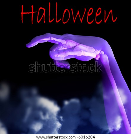 A conceptual image of a x-rayed hand that you can see the bone under the skin, would make a suitable image for Halloween. With added fog effect. - stock photo