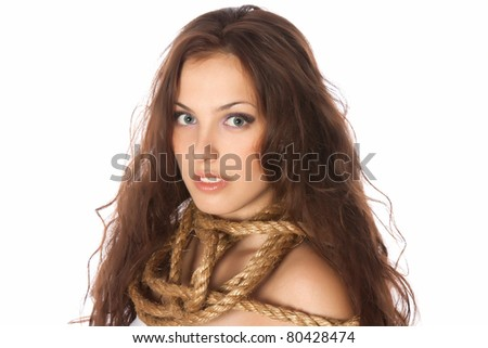 a conceptual image of a young red long hair  beautiful attractive sensual woman trapped in rope wrapped on neck isolated over white background,