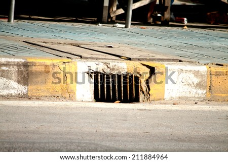 A concrete drain cover - stock photo