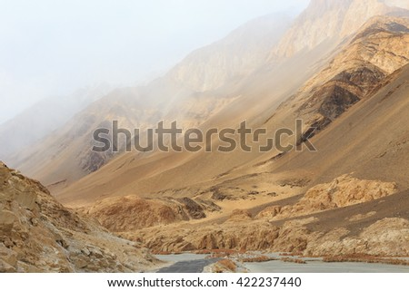 A concrete road towards with peaks of Himalaya, Leh, Ladakh, Jammu and Kashmir, India