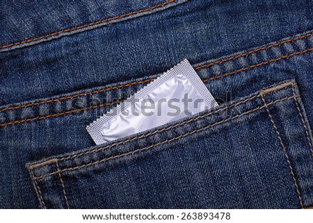 A condom in my pocket jeans - stock photo