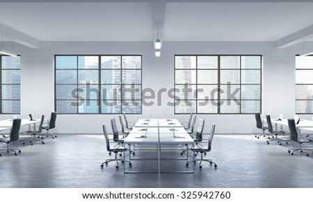 A conference room or corporate workplaces equipped by modern laptops in a modern panoramic office in Singapore. Black leather chairs and a white table. 3D rendering. - stock photo