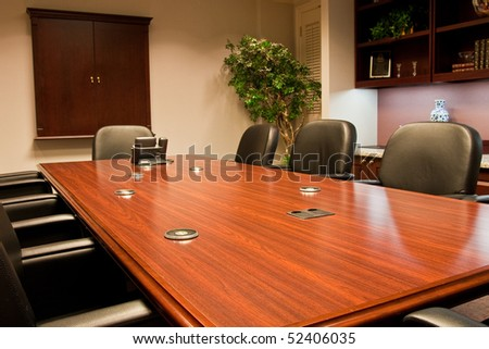 A conference room table in a meeting room of an office