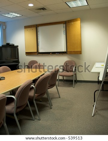 A conference room with a blank whiteboard, and a videoconference terminal - Vertical crop