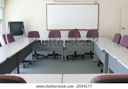A conference room with the tables arranged to form a square