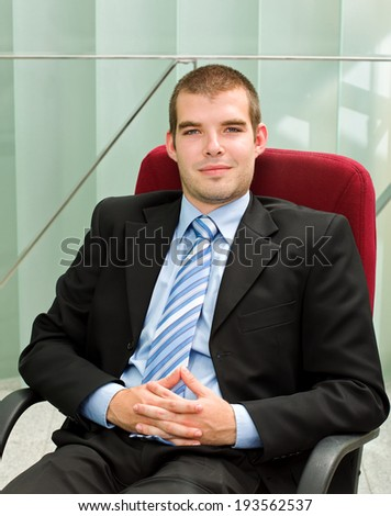 A confident businessman sitting in his office