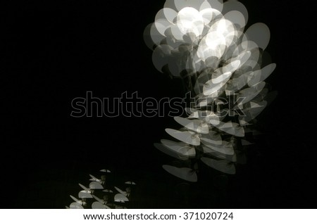 A constructed black and white digital illustration of multiple exposure of Marseilles street lights, France - stock photo