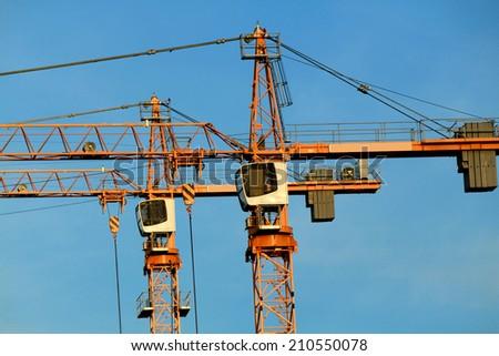 A construction crane on blue sky  - stock photo
