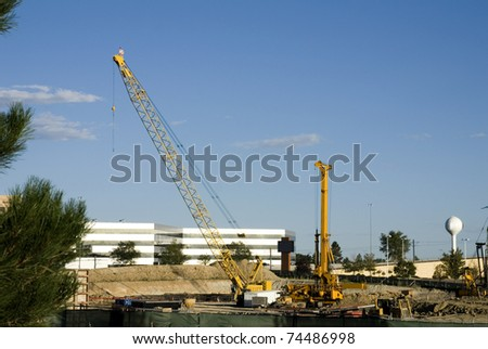 A construction site with heavy equipment and a crane
