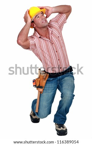 A construction worker afraid of something falling. - stock photo