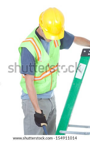 A construction worker gets off a ladder. He is looking down and his face is not seen. Isolated on white. - stock photo
