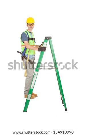 A construction worker in full safety kit climbs a fiberglass construction ladder. Isolated on white. - stock photo