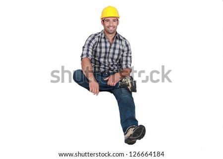 A construction worker levitating. - stock photo