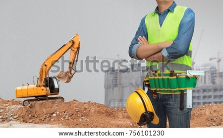 Construction worker man all tools supplies stock photo royalty free a construction worker man with all of tools supplies and articulated wheel crawler loader ready for malvernweather Choice Image