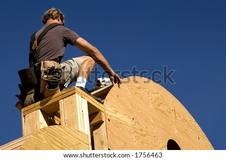 A construction worker measures. - stock photo