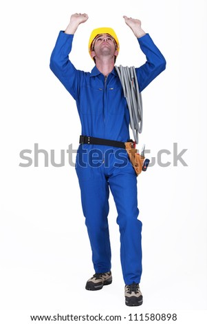 A construction worker raising his hands. - stock photo
