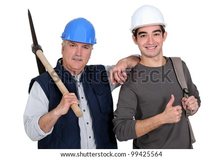 A construction worker teaching his job. - stock photo